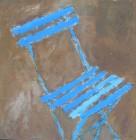 La chaise de jardin attend la pluie
